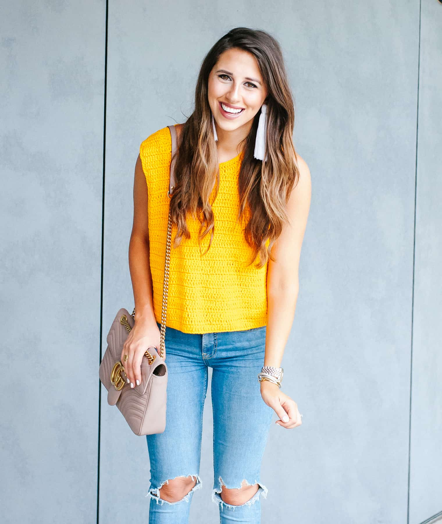 Dress Up Buttercup, Dede Raad, Houston Blogger, Fashion Blogger, Mellow Knit Yellow, knit top, ripped jeans, tassel earrings